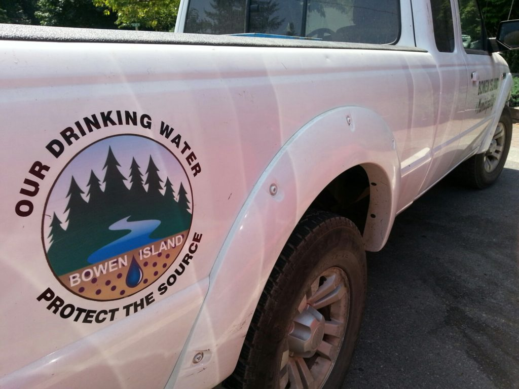 A logo reads Our drinking water: protect the source - on a municipality truck